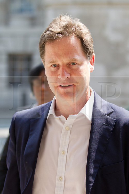 © Licensed to London News Pictures. 05/07/2013. London, UK. Nick Clegg, the British Deputy Prime Minister, arrives on Whitehall in London today (05/07/2013) for a meeting with Duwayne Brooks, friend of murder victim Stephen Lawrence, over allegations that the Metropolitan Police Service bugged meetings between themselves, Brooks and his lawyers in an effort to smear the Lawrence family and their friends. Photo credit: Matt Cetti-Roberts/LNP