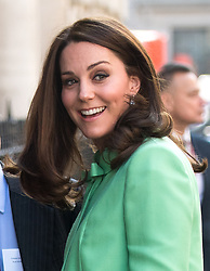 Catherine, Duchess of Cambridge, wearing a mint green Jenny Packham coat and matching dress, visits the Royal Society of Medicine in London on March 21, 2018.