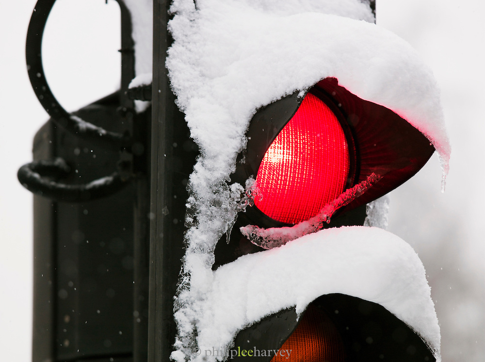 Traffic lights covered in snow in London, UK