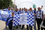 a group of Sheffield Wednesday fans pose outside Wembley Stadium before k/o.Skybet football league Championship play off final match, Hull city v Sheffield Wednesday at Wembley Stadium in London on Saturday 28th May 2016.<br /> pic by John Patrick Fletcher, Andrew Orchard sports photography.