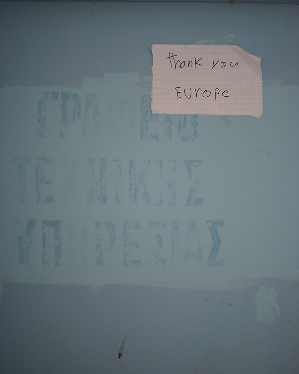 A handwritten note on a door at PIKPA, a refuge opened in January 2016 by the Leros Solidarity Network as a shelter for families and unaccompanied minors.