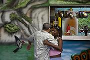 A couple samba in an open-air bar