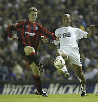 Photo Aidan Ellis.<br />Leeds United v Huddersfield Town.<br />Coca-Cola cup Round 1.<br />24/08/2004.<br />Huudersfield's John Mcaliskey and Leeds Clarke Carlisle