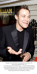 Singer WILL YOUNG at a party in London on 29th May 2002.	PAM 113