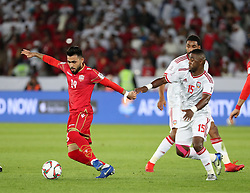 ABU DHABI, Jan. 6, 2019  Bahrain's Komail Hasan Alaswad (L) controls the ball against Ismail Salem Alhammadi of the United Arab Emirates.    during the opening match of the AFC Asian Cup UAE 2019 in Abu Dhabi, the United Arab Emirates (UAE), on Jan. 5, 2019. The match ended in a 1-1 draw. (Credit Image: © Lg/Xinhua via ZUMA Wire)