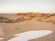 The Flaming Cliffs site, a region of the Gobi Desert in which important fossil finds have been made. It was given this name by American paleontologist Roy Chapman Andrews, who visited in the 1920s. The area is most famous for yielding the first discovery of dinosaur eggs. <br /> Road trip with a Jeep in the Gobi region.