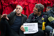 Jonathan  Bartley, Co Leader of the Green Party sits with journolist George Monbiot on Whitehall  on 16th October 2019 in England, United Kingdom. This is despite the police imposing a section 14 of the Public Order Act 1986, in effect banning all protest by the group in London. The group demand that the government take urgent action to tackle climate change. as Extinction Rebellion climate activists sit down in the road despite the police imposing a section 14 of the Public Order Act 1986 order in effect banning all protest by the group in London. photo by Claire Doherty/In Pictures via Getty Images