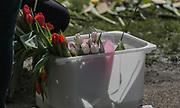 13th, March, 2021. Cheltenham, England. A box of flowers reading for laying in memory of Sarah Everard.