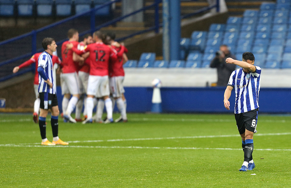 Sheffield Wednesday's Joey Pelupessy reacts as Queens Park Rangers celebrate scoring their equalising goal to make the score 1 - 1<br /> <br /> Photographer Rich Linley/CameraSport<br /> <br /> The EFL Sky Bet Championship - Sheffield Wednesday v Queens Park Rangers - Saturday 3rd October 2020 - Hillsborough Stadium - Sheffield <br /> <br /> World Copyright © 2020 CameraSport. All rights reserved. 43 Linden Ave. Countesthorpe. Leicester. England. LE8 5PG - Tel: +44 (0) 116 277 4147 - admin@camerasport.com - www.camerasport.com