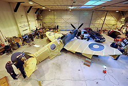 "© Licensed to London News Pictures. File picture dated 13/12/2012. Bristol, UK. Steve Atkin and Alec Kinane of Warbird Colour repainting a Mark IX Spitfire.Engineers race to finish work rebuilding a Mark IX Spitfire fighter circa 1943, at Filton airfield near Bristol. The plane has been rebuilt  by John Hart engineering, it is the last plane to be completed at the airfield and was flown out on 18 December 2012 by pilot Bill Perrins. Filton, the birthplace of the British-built Concorde jets, is to close on Friday (21st December 2012). Its owner BAE Systems says it is not viable and intends to sell it for housing and business development. BAE Systems said the airfield was closing following a comprehensive assessment over a five-year period and an independent review, ""both of which concluded that the airfield was not economically viable"".  Airbus has said it is fully committed to the Filton site, where it has a base making aircraft wings.  A spokesman said: ""The closure of the airfield will have no significant effect on our business and we have mitigation plans in place regarding the change of venue for our passenger shuttle (using Bristol airport) and the transportation of the A400M wings (via Portbury docks).  Planes currently based at Filton will have to find new homes. The airfield officially closes for flights this Friday, though the police helicopter will still be based there. BAE is supporting a new museum at Filton to ""house Concorde Alpha-Foxtrot and Bristol's aviation heritage."".Photo credit : Simon Chapman/LNP"