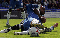 Photo: Paul Thomas.<br /> Oldham Athletic v Swansea City. Coca Cola League 1. 12/08/2006.<br /> <br /> Leon Knight (L) of Swansea tackles Simon Charlton.
