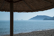 Calm blue sea view seen from sandy beach, Chios town, Chios, Greece