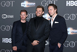 Johannes Lassen (left) and Pilou Asbaek (centre), and guest attending the Game of Thrones Premiere, held at Waterfront Hall, Belfast.