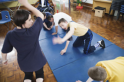 Children with physical and learning disabilities exercising,