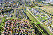 Nederland, Noord-Brabant, Roosendaal, 23-10-2013;<br /> Nieuwbouwwijk met vrijstaande villa's en andere woonhuizen.<br /> Newly constructed residential area with detached houses. Empty lots for newly to be constructed houses (right).<br /> luchtfoto (toeslag op standaard tarieven);<br /> aerial photo (additional fee required);<br /> copyright foto/photo Siebe Swart.