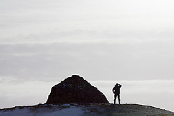 © Licensed to London News Pictures. 14/01/2015. Wheddon Cross, Devon, UK. A man stops to take in the view from Dunkery Beacon in Exmoor National Park, Devon this morning, 14th January 2015. Snow has fallen overnight across many parts of England, causing travel disruption in some areas.  Photo credit : Rob Arnold/LNP