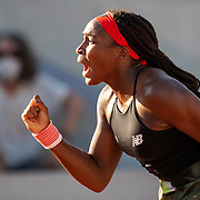 PARIS, FRANCE June 1.  Coco Gauff of the United States celebrates after winning the fist set tie break against Aleksandra Krunic of Serbia on court six during the first round of the singles competition at the 2021 French Open Tennis Tournament at Roland Garros on June 1st 2021 in Paris, France. (Photo by Tim Clayton/Corbis via Getty Images)