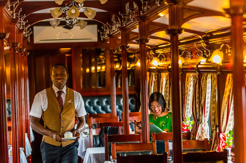 Breakfast in the pillared pre-1940s dining car on the luxury Rovos Rail train between Pretoria and Cape Town, South Africa.