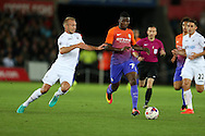 Kelechi Iheanacho of Manchester city © looks to get away from Mike Van der Hoorn of Swansea city (l).  EFL Cup. 3rd round match, Swansea city v Manchester city at the Liberty Stadium in Swansea, South Wales on Wednesday 21st September 2016.<br /> pic by  Andrew Orchard, Andrew Orchard sports photography.