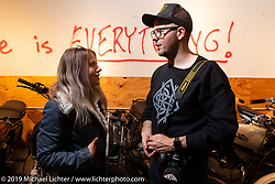 Malary Lee (L) and Revival's Cycles' staff photographer Brandon LaJoie at Revivals Cycles after-party for the Handbuilt Show. Austin, Austin USA. Sunday, April 14, 2019. Photography ©2019 Michael Lichter.