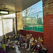 A memorial has been placed where murdered school boy Damilola Taylor died at Hordle Promenade, North Peckham Estate, London, UK. Were we to ignore this place where someone's life ended, the victim would just be an anonymous statistic but flowers are left to die too and touching poems and dedications are written by family and loved-ones. One reads: ?May your sweet little soul rest in perfect Peace/?Evil kids has took your life away (but your spirit is always with us).? From a project about makeshift shrines: Britons have long installed memorials in the landscape: Statues and monuments to war heroes, Princesses and the socially privileged. But nowadays we lay wreaths to those who die suddenly - ordinary folk killed as pedestrians, as drivers or by alcohol, all celebrated on our roadsides and in cities with simple, haunting roadside remberences..
