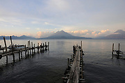 Early morning view across Lake Atitlan from Panajachel. To the left are Volcan Toliman, 3153m,    and, behind it,  Volcan Atltlan, 3525m. The hill in front is Cerro de Oro. To the right is Volcan San Pedro 3020m.. Panajachel, Republic of Guatemala. 04Mar14.