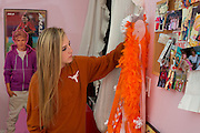 Haley Berg, 15, adjusts a mum in her bedroom in Celina, Texas on January 23, 2014. Berg, a freshman at Celina High School, began receiving attention from top collegiate soccer programs when she was 13 and has already committed to the University of Texas. (Cooper Neill / for The New York Times)