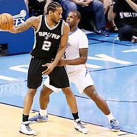 06 May 2016: San Antonio Spurs forward Kawhi Leonard (2) posts up Oklahoma City Thunder guard Dion Waiters (3) during the San Antonio Spurs 100-96 victory over the Oklahoma City Thunder, during Game Three of the Western Conference Semifinals of the NBA Playoffs at the Chesapeake Energy Arena, Oklahoma City, Oklahoma, USA.