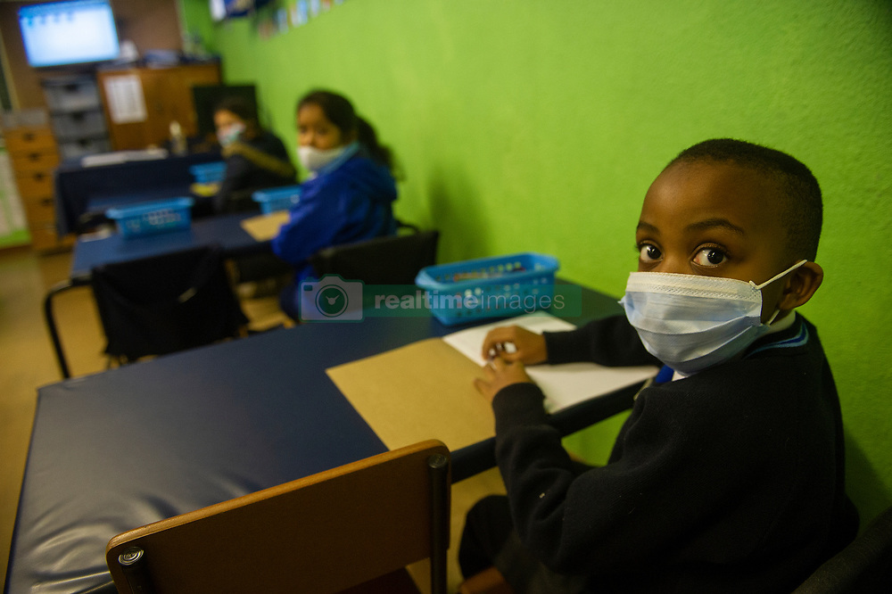 South Africa - Cape Town - 6 July 2020 - Coronavirus - Grade 1 in class. Goodwood Park Primary along with other primary schools across the country had their grade 1 and 6 return for learning today during the COVID-19 pandemic lockdown level 3. The kids are screened once entering the school. Once in class, they are seated socially distanced apart. They are shown an educational video on how the school will operate and what they need to do to stay safe while at school. During break, there are demarcated areas where they exercise and if its a nice day, they will sit and have their lunch but for now they have their lunch in class. They remove their masks while eating, other than that they keep their masks on and a visor is optional. If a learner wants to use the toilet, the whole class lines up for the toilet break. Picture Courtney Africa/African News Agency(ANA)