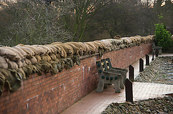 © Licensed to London News Pictures. 28/12/2015. Cawood, UK. Sandbags and a flood defence wall in the town of Cawood in North Yorkshire where flood water and rising tides have threatened the town on December 28, 2015. Several warnings of risk to life are sill in place in parts of Lancashire and Yorkshire where rainfall has been unusually high, causing heavy flooding. Photo credit: Ben Cawthra/LNP