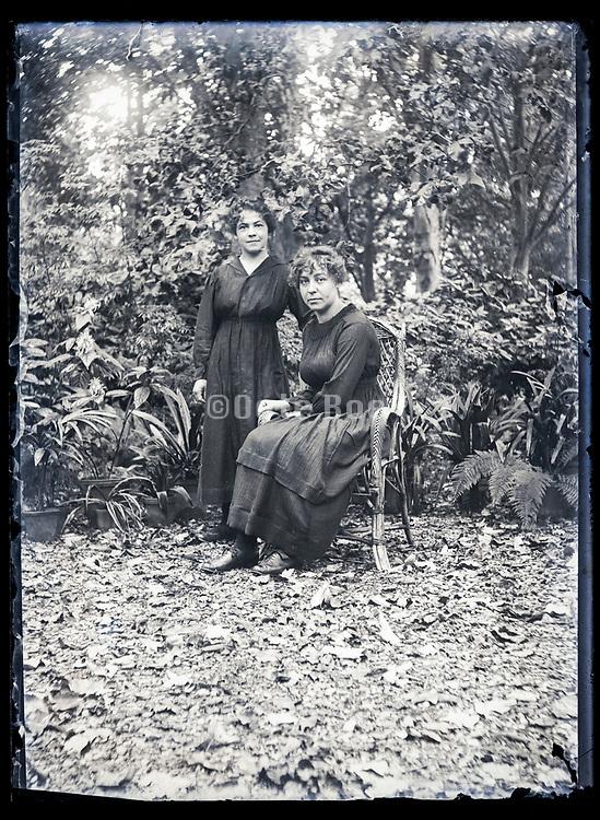 two women posing in garden setting France ca 1920s