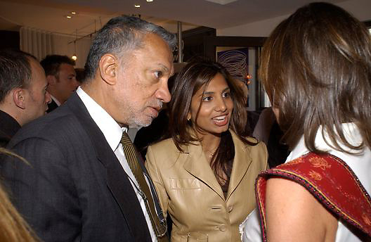 Gulu Lalvani and Divia Lalvani, Art Review/ Chaplins Milan event, 118-120 Brompton Rd. London. 7 May 2003. © Copyright Photograph by Dafydd Jones 66 Stockwell Park Rd. London SW9 0DA Tel 020 7733 0108 www.dafjones.com