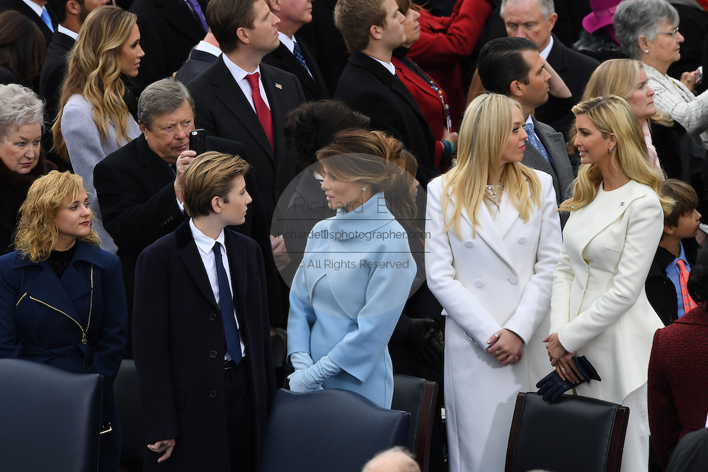 Melania Trump stands with son Baron Trump as Tiffany Trump and Ivanka Trump stand to the right during the 68th President Inaugural Ceremony on Capitol Hill January 20, 2017 in Washington, DC. Donald Trump became the 45th President of the United States in the ceremony.