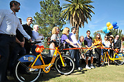 Mayor Jonathan Rothschild cuts the ribbon that marks the beginning of Tugo Bike Share service in Tucson.