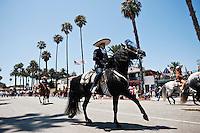 Horse rider in traditional costume in Fiesta parade, Santa Barbara, California, USA