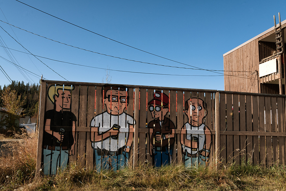 Artwork adorns a fence in downtown Whitehorse, Yukon