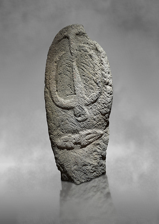 Late European Neolithic prehistoric Menhir standing stone with carvings on its face side. The representation of a stylalised male figure starts at the top with a long nose from which 2 eyebrows arch around the top of the stone. below this is a carving of a falling figure with head at the bottom and 2 curved arms encircling a body above. at the bottom is a carving of a dagger running horizontally across the menhir.  Excavated from Barrili II site,  Laconi. Menhir Museum, Museo della Statuaria Prehistorica in Sardegna, Museum of Prehoistoric Sardinian Statues, Palazzo Aymerich, Laconi, Sardinia, Italy .<br /> <br /> Visit our PREHISTORIC PLACES PHOTO COLLECTIONS for more photos to download or buy as prints https://funkystock.photoshelter.com/gallery-collection/Prehistoric-Neolithic-Sites-Art-Artefacts-Pictures-Photos/C0000tfxw63zrUT4