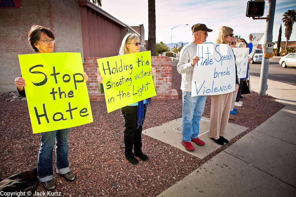 tucsonshooting - 09 JANUARY 2011 - TUCSON, AZ: Cathy Amanti (CQ) LEFT, Patricia Walsh (CQ), Richard Fridena (CQ) and his wife, Betty Fridena, (CQ) all members of the Pima Friends Meeting (Quakers) stand on the corner of Speedway and Euclid in Tucson Sunday protesting against hate speech that they say led to the mass shooting in Tucson Saturday.   ARIZONA REPUBLIC PHOTO BY JACK KURTZ
