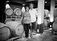 Husband and wife team Santiago Santamaria (right) and Clarisa Aristi, of Bodega Melipal, stand in amonst oak casks at the winery in the Luján de Cuyo area of Mendoza, Argentina.