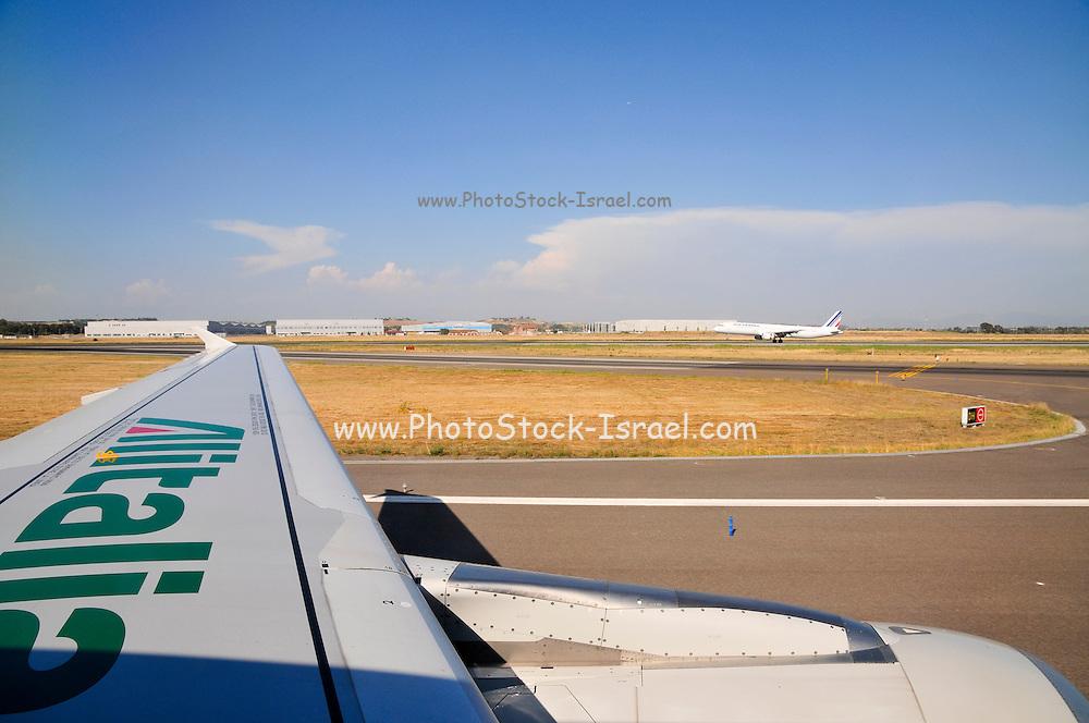Alitalia flight lands at Leonardo da Vinci-Fiumicino Airport (FCO) Near Rome, Italy