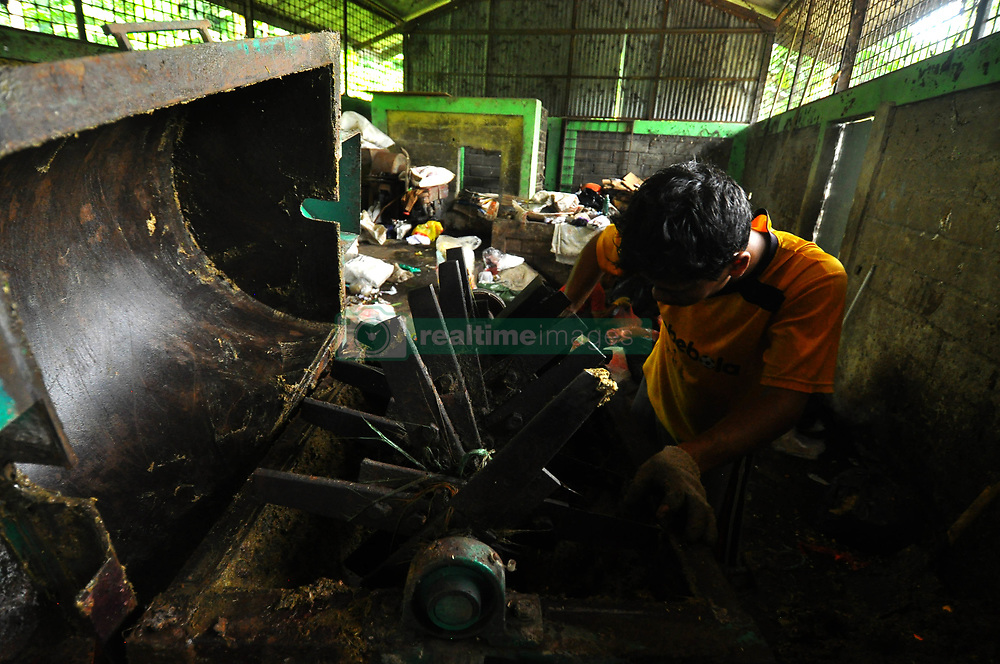 April 12, 2018 - Bogor, west java, Indonesia - Waste Management Site (TPS) 3R (Reuse, Reduce, Recycle) is a waste recycling site for re-use as a value-added recycling product. Located in Cibereum highway, Mulyaharja Sub-district, Bogor City, West Java. This waste management site, in a day can carry as many as 15 cubic meters of household waste and restaurant in 7 areas in Mulyaharja Sub-district. This garbage is processed by using three machines that are machine enumerator and sieve machine for organic waste and press machine for non organic waste. For organic waste can be made into a natural fertilizer (compost) or made biogas as a power plant. Meanwhile, non-organic waste will be pressed for resale. From this waste recycle, in a month, average income is Rp 1.200.000 rupiah  (Credit Image: © Andi Muh Ridwan/Pacific Press via ZUMA Wire)