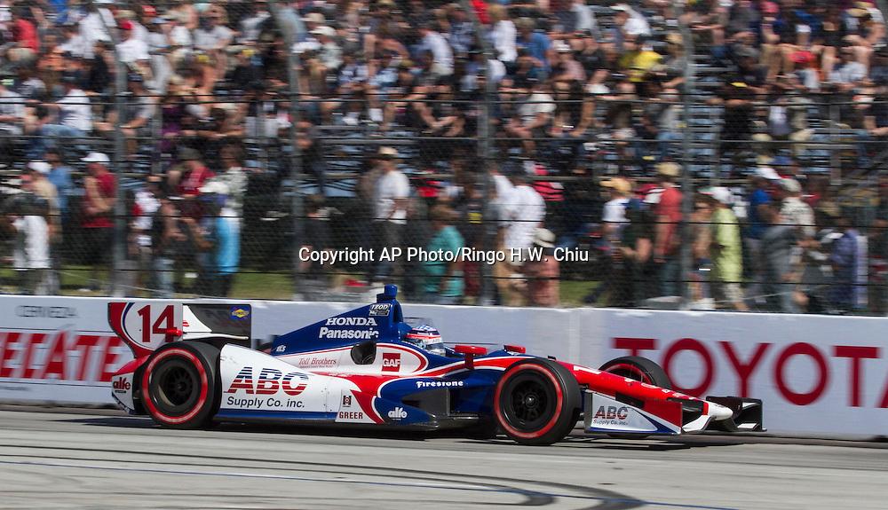 Takuma Sato (14) of Japan, races during the Indy Car Series' Grand Prix of Long Beach auto race, Sunday, April 21, 2013, in Long Beach, Calif.  (AP Photo/Ringo H.W. Chiu)
