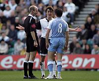 Photo: Paul Thomas.<br /> Preston North End v Manchester City. The FA Cup. 18/02/2007.<br /> <br /> Referee Mike Riley (L) controls Danny Pugh (C) and Joey Barton of Man City.