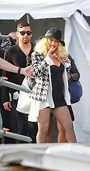 02 May 2014. New Orleans, Louisiana.<br /> Christina Aguilera heads toward the stage at the New Orleans Jazz and Heritage Festival. <br /> Photo; Charlie Varley/varleypix.com