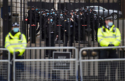© Licensed to London News Pictures. 14/03/2021. London, UK. Heightened police presence at Downing Street during a demonstration, organised by Sisters Uncut, against the actions of the police force at a vigil for murdered Sarah Everard yesterday evening. There have been calls for Met Chief Cressida Dick to resign following yesterday's scenes, when police dragged women away from a bandstand as thousands gathered in Clapham, South London. Photo credit: Ben Cawthra/LNP