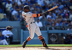 March 29, 2018 - Los Angeles, CA, U.S. - LOS ANGELES, CA - MARCH 29: San Francisco Giants Right field Andrew McCutchen (22) hits for a base hit during the MLB opening day game between the San Francisco Giants and the Los Angeles Dodgers on March 29, 2018 at Dodger Stadium in Los Angeles, CA. (Photo by Chris Williams/Icon Sportswire) (Credit Image: © Chris Williams/Icon SMI via ZUMA Press)