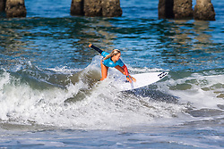 Kayla Coscino (USA) advances to the Quarterfinals of the 2918 Junior Women's VANS US Open of Surfing after placing second in Heat 4 of Round 1 at Huntington Beach, CA, USA.