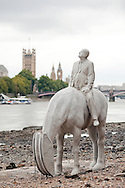 'The Rising Tide', sculpture instalation by Jason Decaires Taylor, between Vauxhall Bridge and the Houses of Parliament on the River Thames, London, UK (5 September 2015). The sculptures of the four horses and riders, which were in place during the month for September 2015, are only revealed at low tide. © Rudolf Abraham