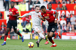Manchester United's Marcus Rashford (right) and Liverpool's Xherdan Shaqiri battle for the ball during the Premier League match at Old Trafford, Manchester.
