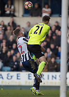 Football - 2016 / 2017 FA Cup - Fifth Round: Millwall vs. Leicester City <br /> <br /> Ron-Robert Zieler of Leicester City leaps into Aiden O'Brien of Millwall to clear the ball at The Den<br /> <br /> COLORSPORT/DANIEL BEARHAM